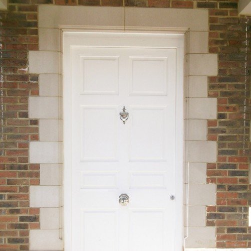 white cast stone door surround