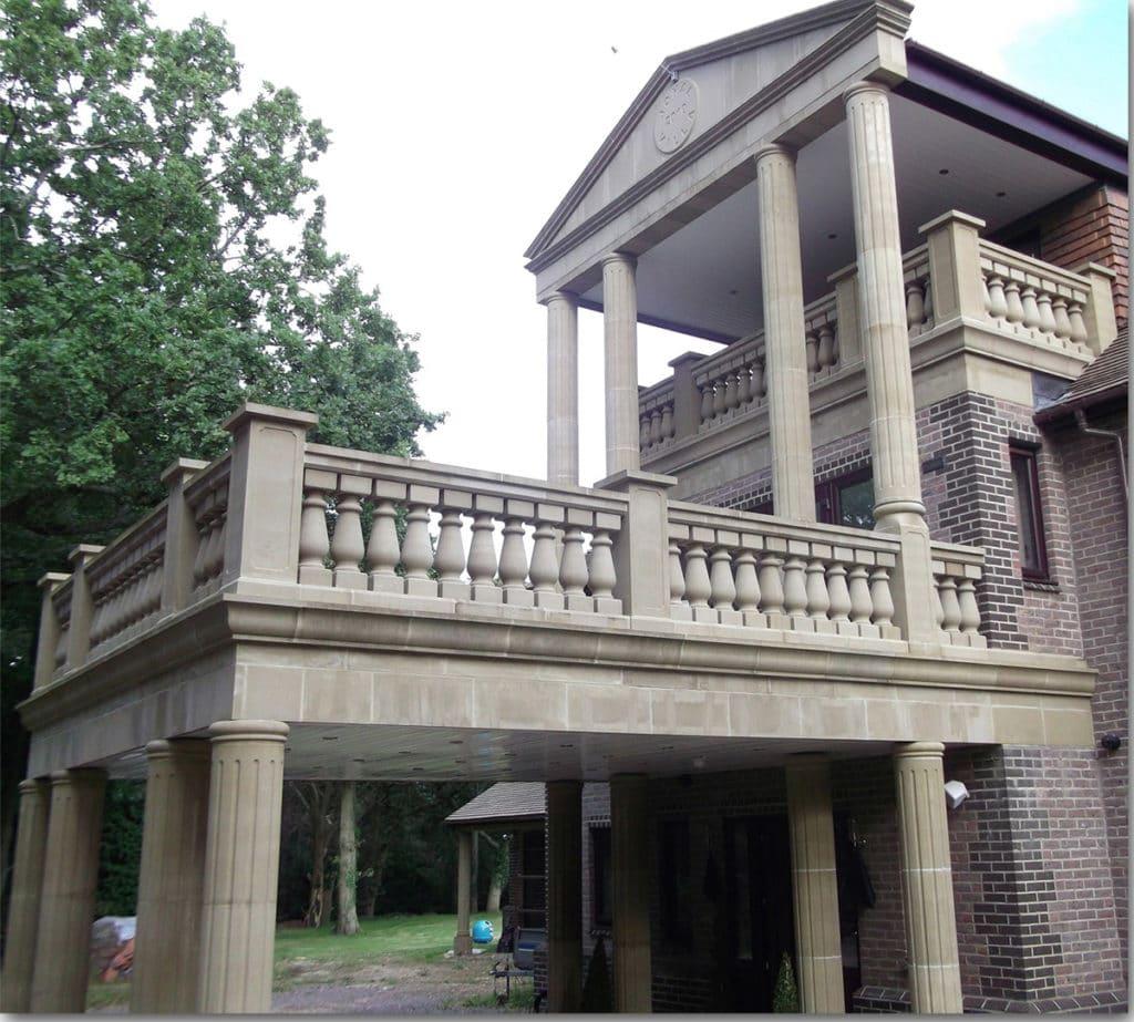 cast stone portico with Flute Column
