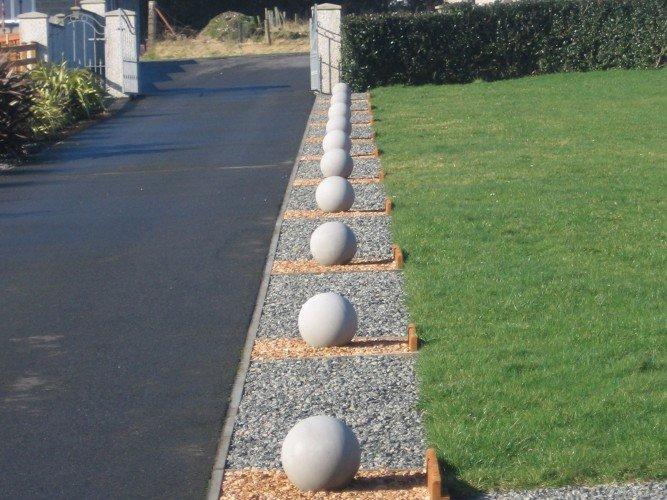 cast stone spheres in a garden