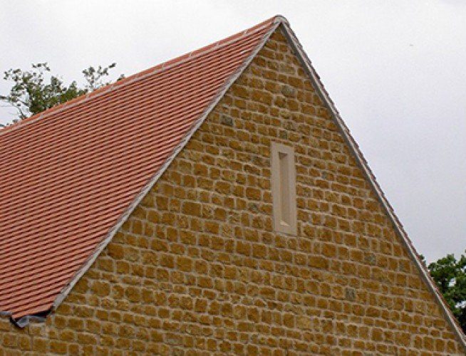 Cast Stone Gable Vent On House Front
